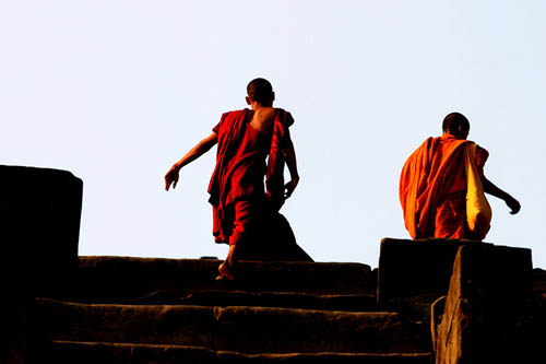 monks climbing at sunrise